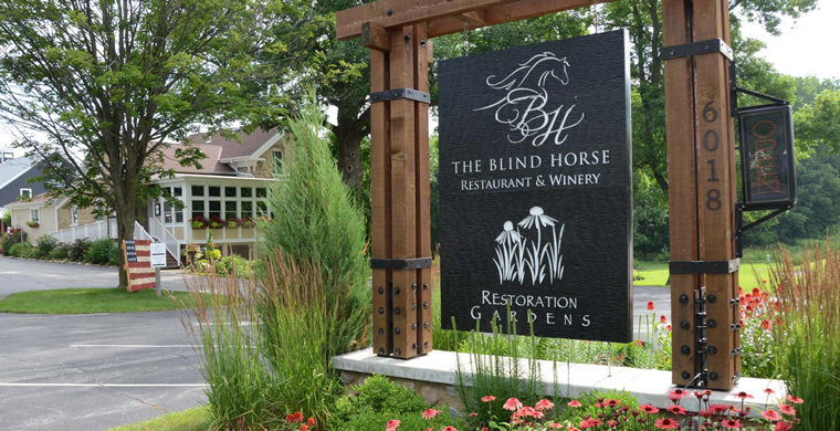 A picture of the Blind Horse Restoration Gardens sign