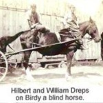 Picture of Hilbert and William Dreps on Birdy, a blind horse.